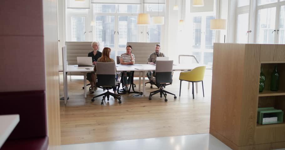 Entrepreneur Skateboarding In To An Office Meeting   4K Stock Video Clip