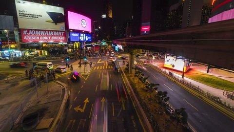 KUALA LUMPUR - APRIL 23: Night time lapse of traffic on Jalan Bukit Bintang in Kuala Lumpur Malaysia on 23 April 2017. Motion Time lapse Pan Up.