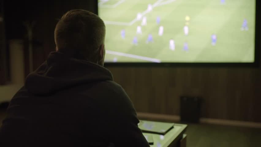 Man watching football on the big screen close-up | Shutterstock HD Video #27736867