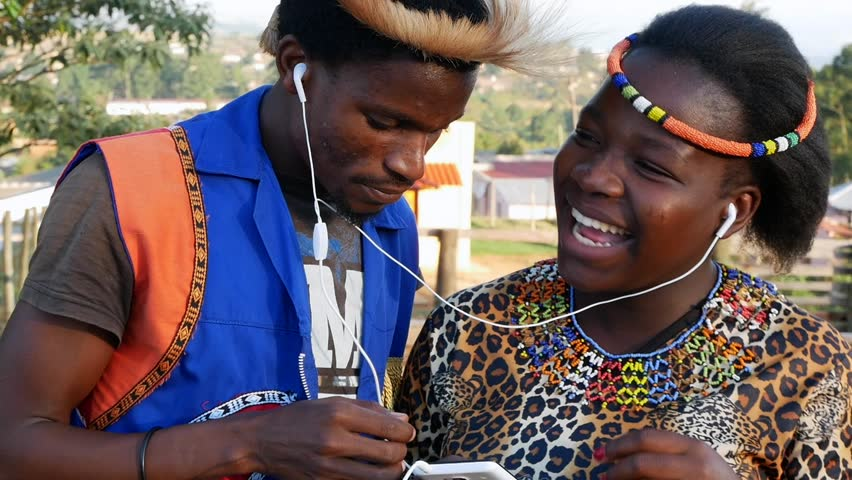 A black South African traditional couple spending their time together listening to music -  in slow motion.