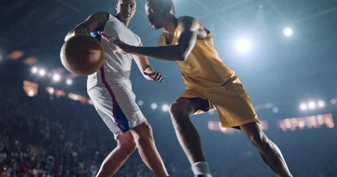 4K footage in slow motion  basketball player dribbling in front of rival player. The action takes place in 3d made basketball arena full of spectators. All players wear unbranded basketball uniform.