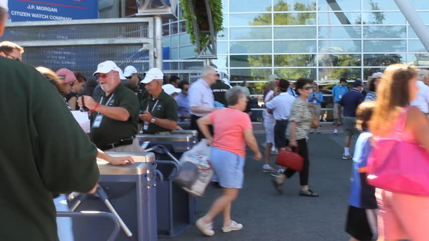 FLUSHING, NEW YORK - SEPT 1: US Open Tennis fans go through turnstiles to enter tournament on September 1, 2012 in Flushing, NY.
