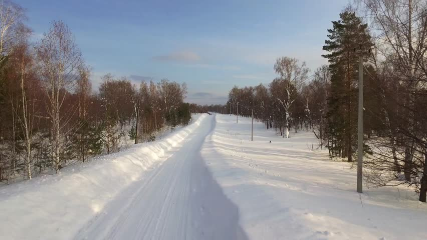 Snowy road in winter wild Ural landscapes / Clean snow road at winter sunset time / empty endless snowy smooth road | Shutterstock HD Video #27809347