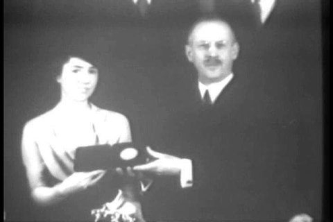 Jane Morrow Lindbergh is awarded the Hubbard Medal by the National Geographic Society in honor of her role as co-pilot to her husband Charles Lindbergh during the aerial surveys he conducted