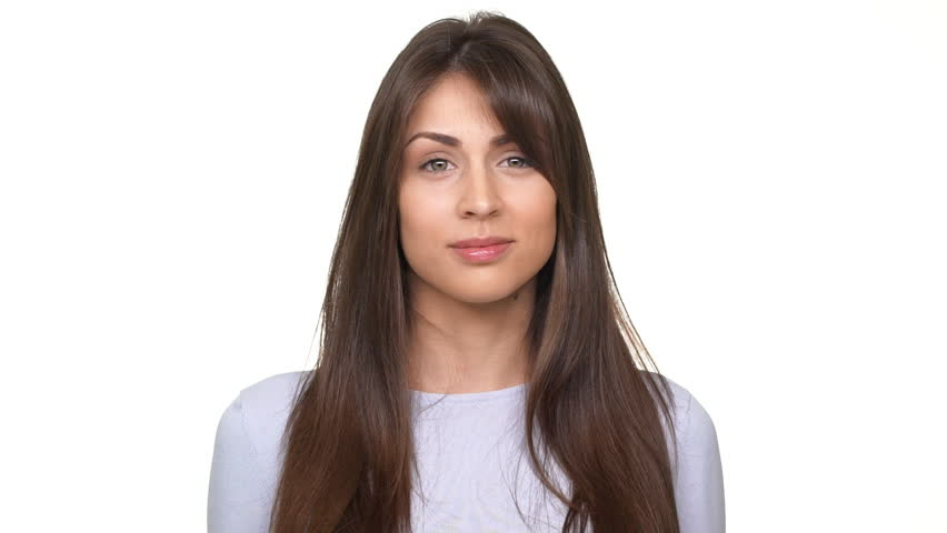 Beautiful Caucasian girl looking haughtily at opponent. Footage over white background in slowmotion | Shutterstock HD Video #27871027