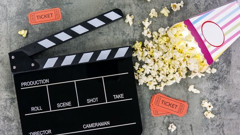 Movie tickets, clapperboard, popcorn close up rotation and scale
