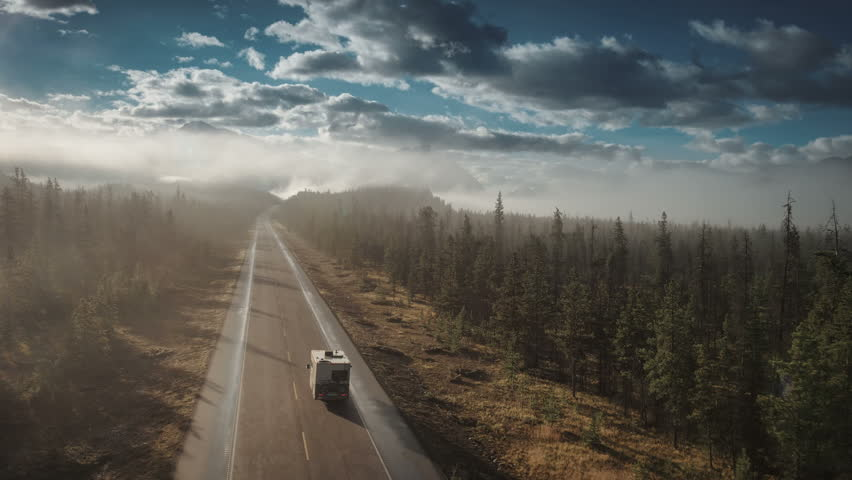 aerial of rv driving on icefields parkway in jasper