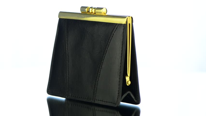 Black leather purse isolated on white background. | Shutterstock HD Video #2790427