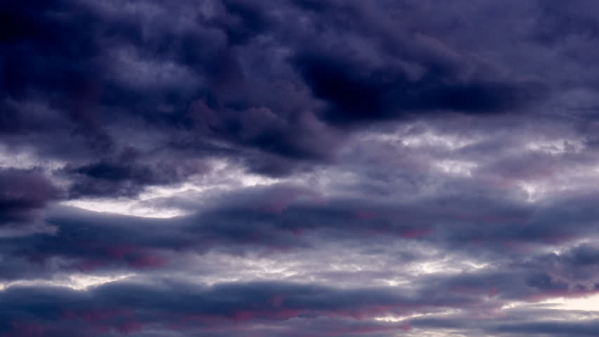 Dark clouds moving storm sky timelapse. Stormy weather dramatic black cloudy nature time lapse. Overcast thunderstorm, cloudscape, gray danger moody hurricane. Rain ominous heaven climate atmosphere.