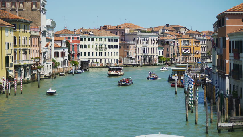 Tourists travel by vaporettos in Venice, beautiful view of Grand Canal, Italy | Shutterstock HD Video #27934717