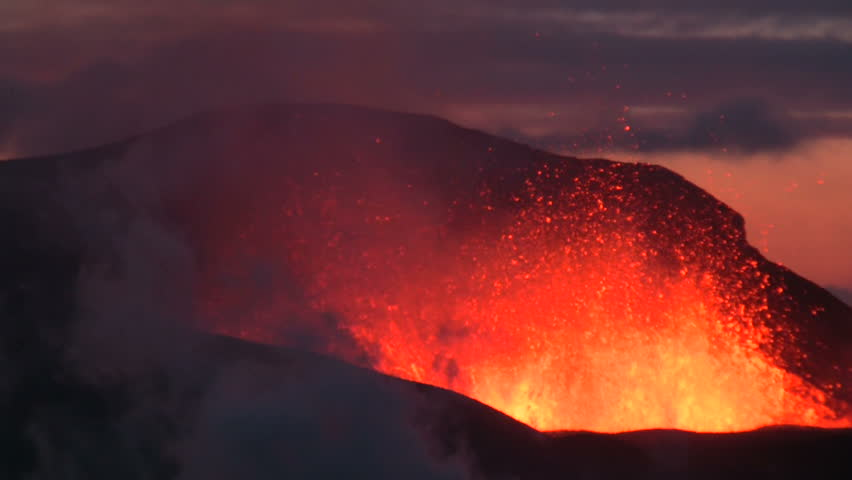 Volcanic Eruption in Iceland  2010 in Eyjafjallajokull. Footage taken in extreme conditions only a half mile from the crater during frequent gas explosions from advancing lava. A mountain is born.