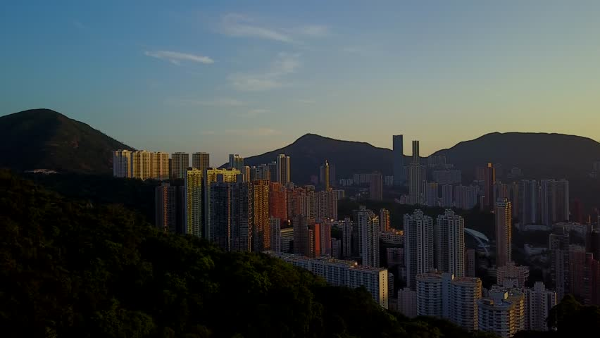 Dark cityscape of dense build areas at Hong Kong Island at sunset, aerial shot. Panning from Happy Valley mansions to Wan Chai and Victoria Harbour perspective. Urban city view against bright sunshine | Shutterstock HD Video #27956737