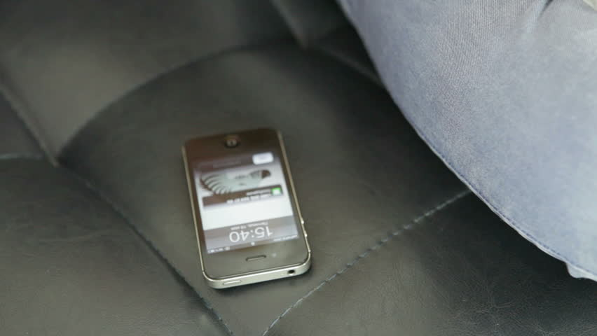 A mobile telephone rings and is picked up