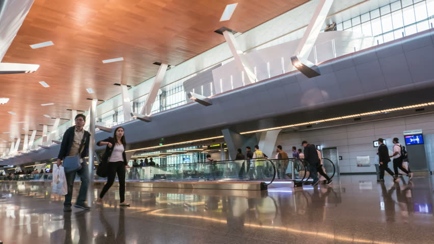 DOHA, QATAR - 26 OCT, 2016 : 4K Timelapse Passengers walk through the modern departure hall of Hamad International Airport in Doha, Qatar.