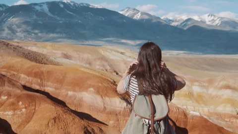 Close up portrait of beautiful young woman in nature with brunette hair blowing in wind looking at mountain view Hiker Girl in Norway Slow Motion.
