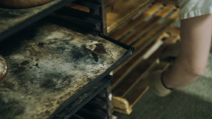 Black bread is removed from trays | Shutterstock HD Video #28013437