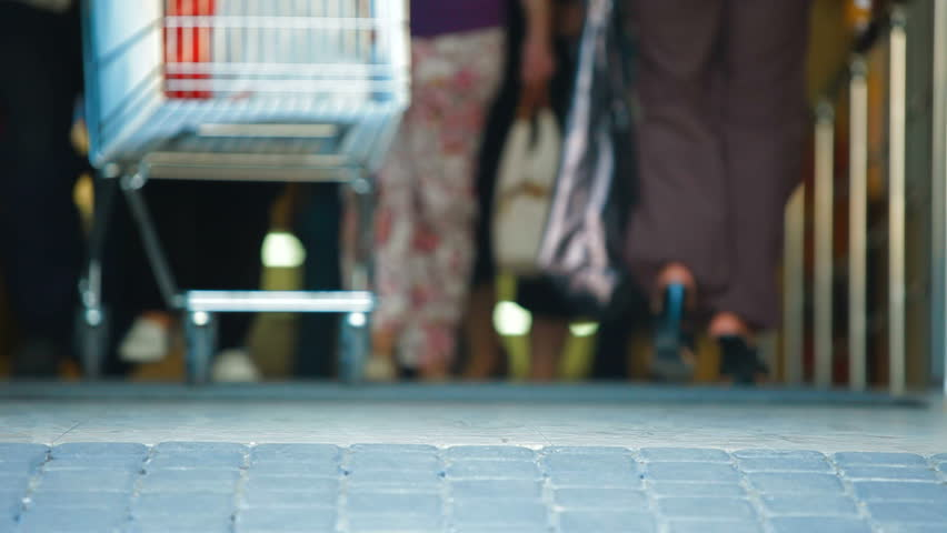 People with Shopping Cart Walking Through the Doors of Supermarket | Shutterstock HD Video #2805844