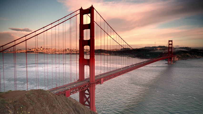 Colorful shot of Golden Gate Bridge with dramatic dark clouds and sky. 4K.