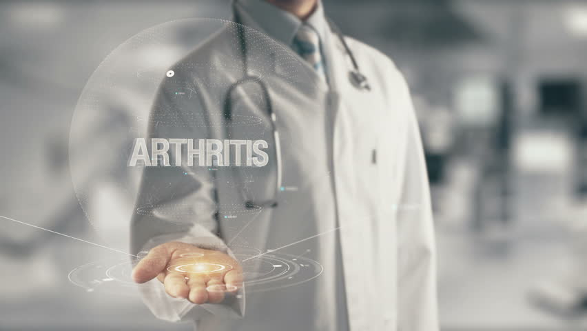 Doctor holding in hand Arthritis | Shutterstock HD Video #28080397