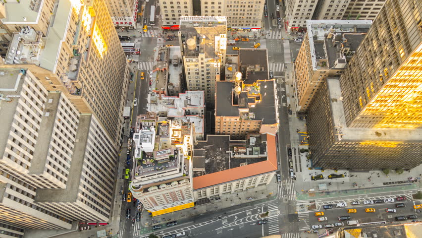 Time lapse! Streets Midtown Manhattan New York City at sunset from 62nd floor – low angle  | Shutterstock HD Video #28101565
