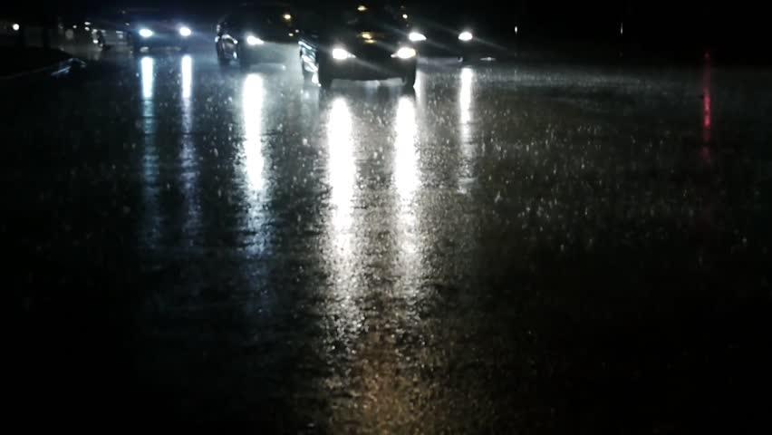 Night traffic driving in heavy rain