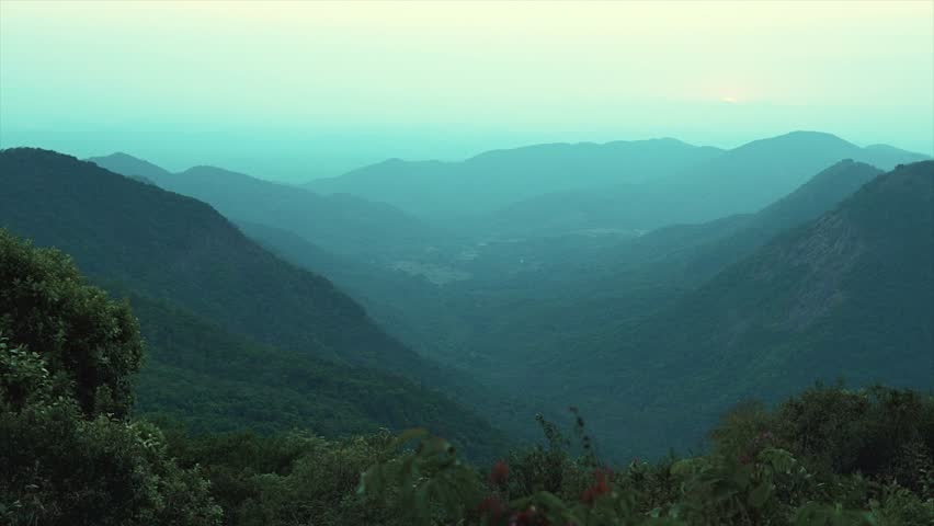 Blue mountains under mist in the morning sun | Shutterstock HD Video #28148062