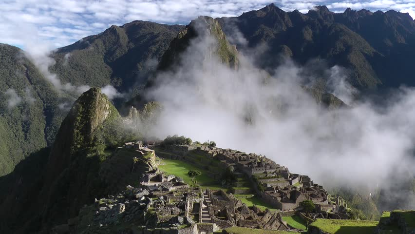 Machu picchu with clouds, ancient city of the inca, Cuzco, Peru