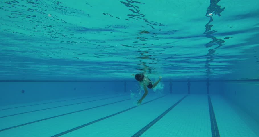 young asian boy swims freestyle and does tumble turn 4k stock footage clip - Olympic Swimming Pool Underwater