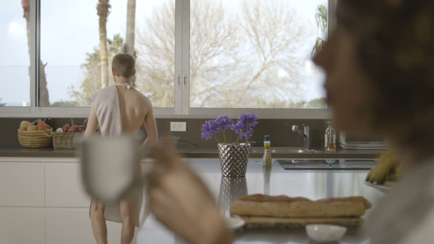 Man cooking breakfast naked wife smiling at him | Shutterstock HD Video #28201177