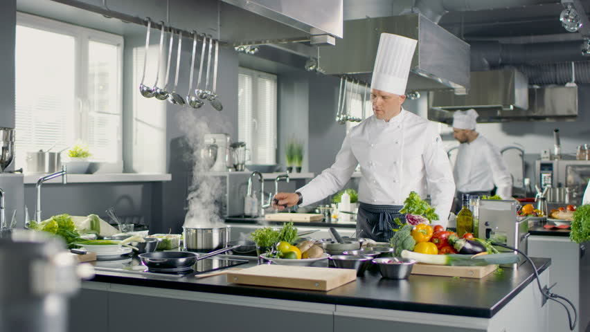 Restaurant Kitchen Chefs big and glamorous restaurant busy kitchen, chefs and cooks working