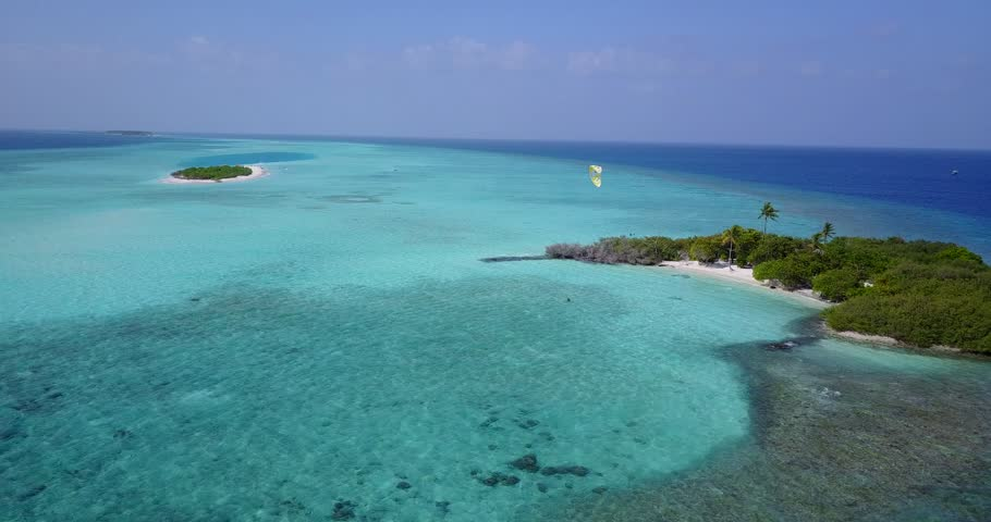 Aerial flying drone view of Maldives white sandy beach on sunny tropical paradise island with aqua blue sky sea water ocean 4k   Shutterstock HD Video #28212727