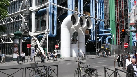 PARIS, FRANCE - MAY 23, 2017: Traffic And The Tubes Pipes Facade Of Bizarre Architecture Building Of Pompidou Center In Paris