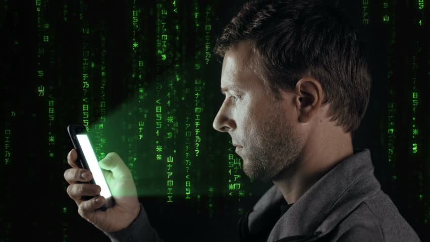 Man with a Smart Phone and Digital Data Background. Computer generated image. In the foreground an adult man using his smart phone, in the background a wall of cascading digital data. #28258687