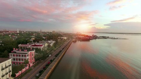 4k cinematic aerial of Charleston SC at sunrise along coast