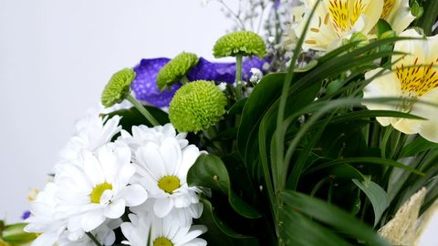Flowers, bouquet, rotation on white background, floral composition consists of Alstroemeria, Chrysanthemum bacardi, Orchid vanda, Santini , gypsophila, Eustoma,