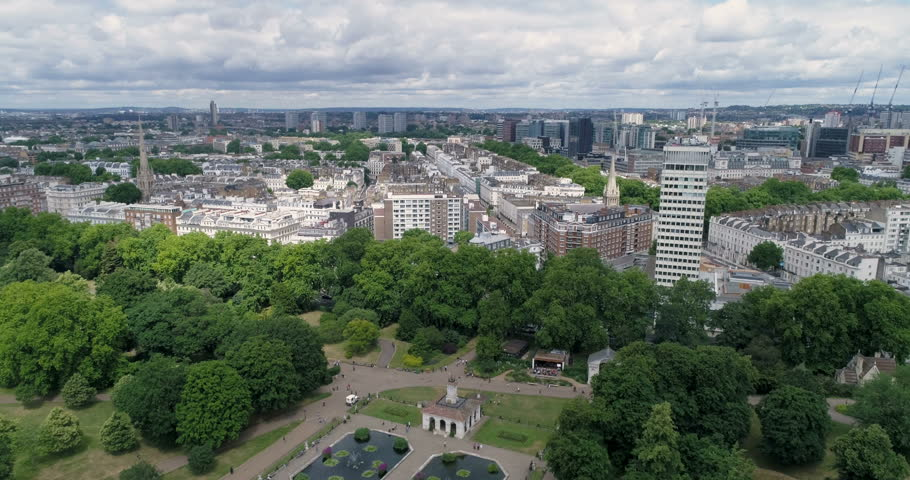 Aerial pull out view of central London by the Italians gardens in Hyde park