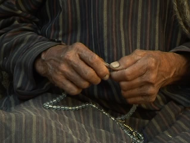 Prayer beads (old man and woman buddhist)