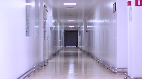Empty hospital corridor interior. Empty hallway hospital. Factory white corridor. Long corridor with doors. Clinic hallway