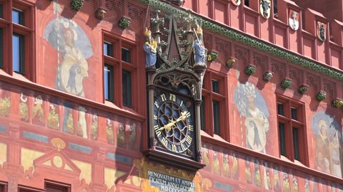 Clock at the red city hall of Basel, Switzerland.