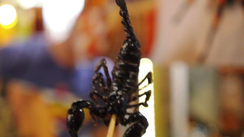 Fried Exotic Scorpion in Chopstick. Closeup. HD, 1920x1080.