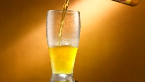 Pouring Cold Beer into a glass with water drops. Craft Beer close up. Rotation 360 degrees. 4K video 3840x2160