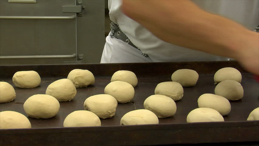 Baker cut into roll bun. Dolly shot. You will find even more GERMAN BAKERY clips in my portfolio!