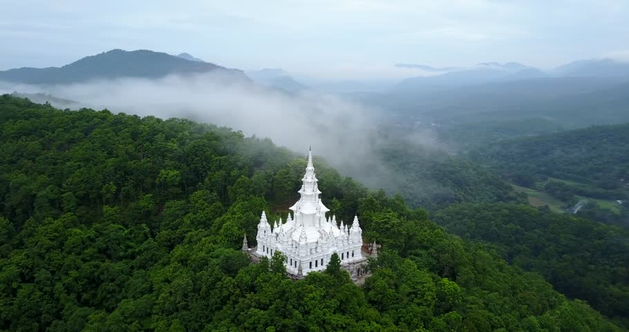 Aerial view, Wat Phra That Ban Pong and the foggy morning in Chiang mai, Thailand.