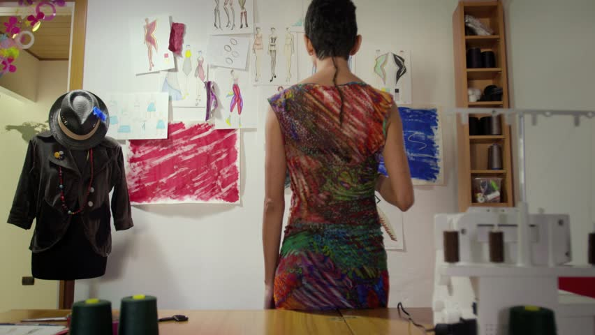 Hispanic woman at work as fashion designer and tailor, looking at sketches in atelier. Sequence | Shutterstock HD Video #2845873