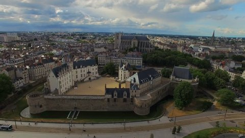 Aerial view of cityscape of Nantes, fort Chateau de Nantes, famous Cathedral of St. Peter and St. Paul - Normandy, France, 4k UHD