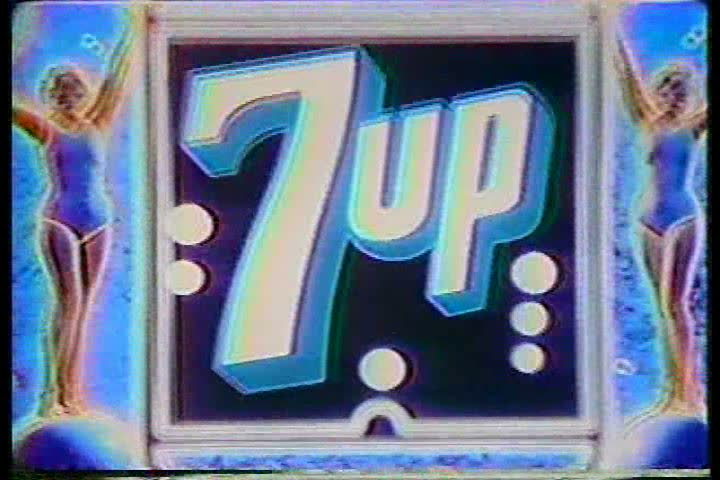 1970s: Showgirls dance in space in a television commercial for 7 Up, in the 1970s.