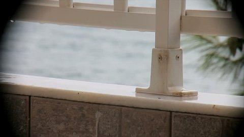rain on the balcony overlooking the sea