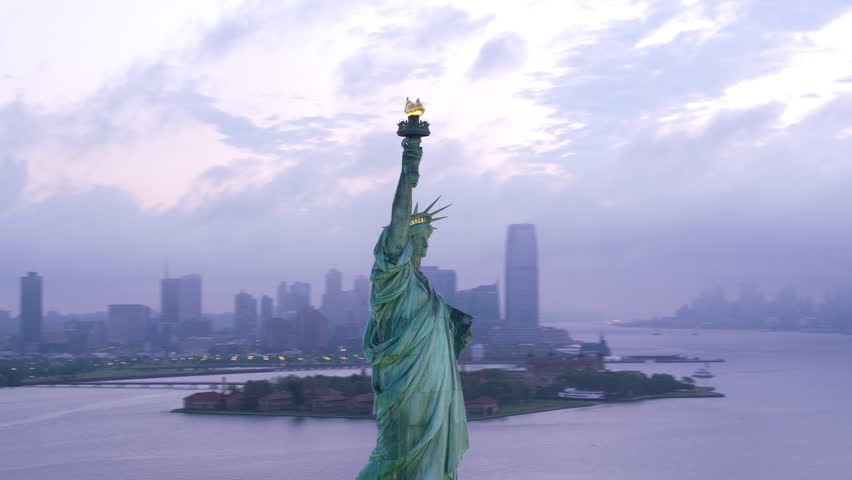 New York City circa-2017, Aerial orbit of Statue of Liberty at sunrise. Shot with Cineflex and RED Epic-W Helium.   Shutterstock HD Video #28500217