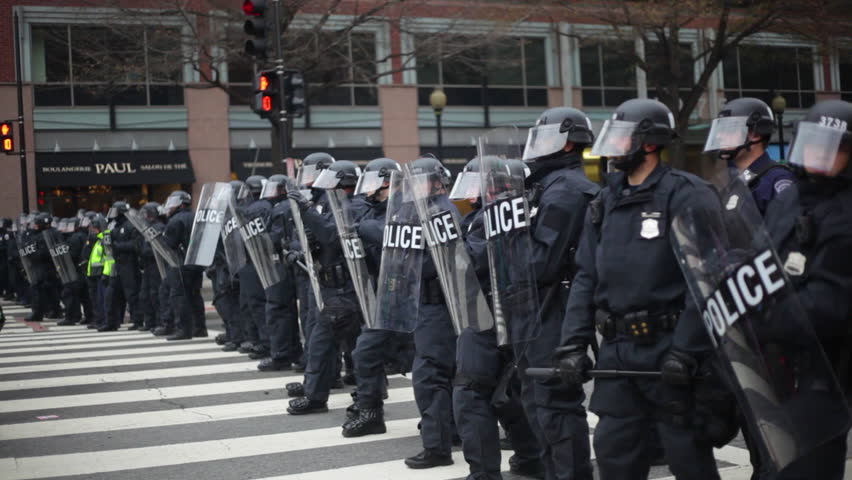 Washington D.C.-2010s: Police in riot gear form a line to confront protestors at Trump's Inauguration in Washington DC.