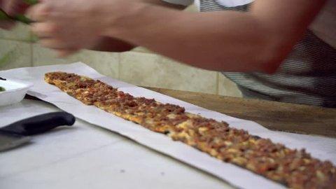 Turkish and Arabic Traditional Ramadan Bread Sliced Etli Ekmek (Pide or Lahmacun) prepared by cook.